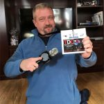 Guest Reporter Dave Stevens showing his TDC pass to the Super Bowl 52