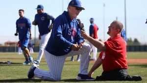 Cubs manager Joe Maddon is interviewed by Dave Stevens of the Disability Channel before a game against the White Sox on Feb. 27, 2018.