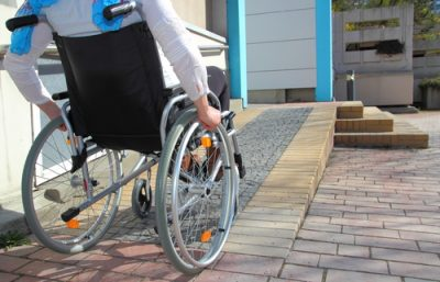 Person in wheelchair using a ramp